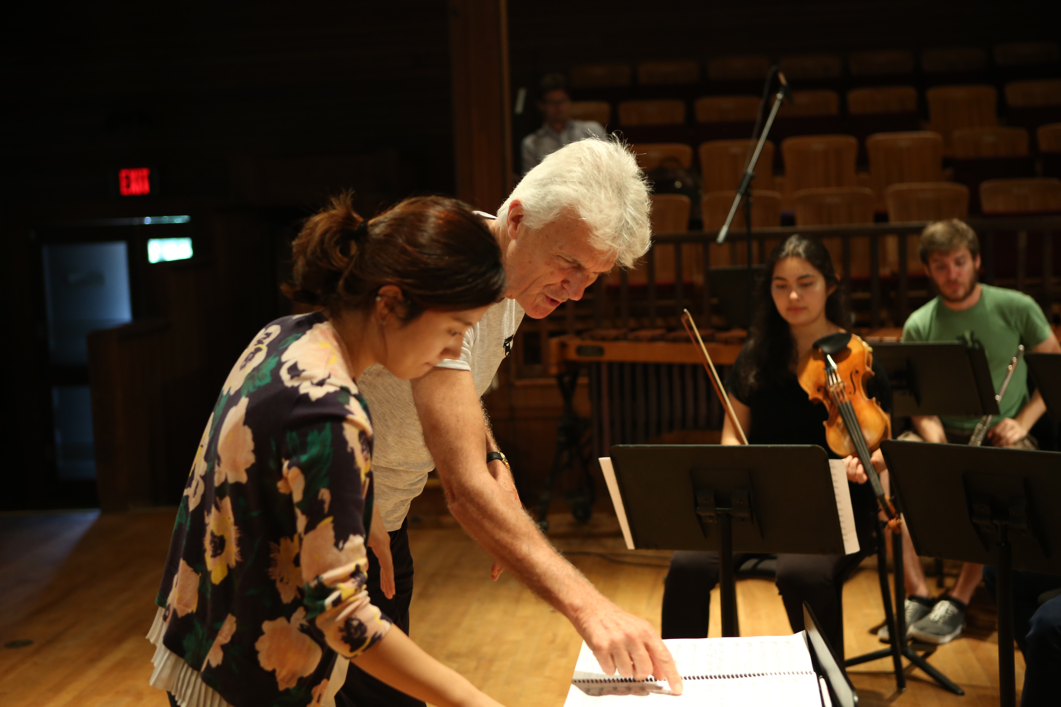 Simon Carrington working with a student conductor
