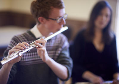A student playing the flute.