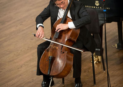 Ole Akahoshi playing cello at the 2014 YSM Convocation.